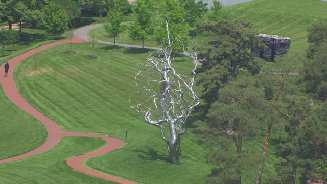 MS AERIAL Shot of Ferment sculpture outside Nelson Atkins Museum of Art with person walking by / Kansas City, Missouri, United States