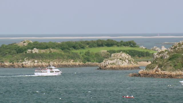 WS AERIAL DS Shot of ferry boat moving ahead in sea at Ile De Brehat island / Brittany, Channel Isles