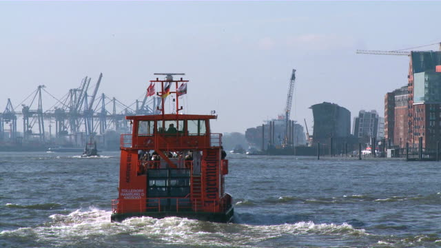 MS Shot of ferry boat moving at Elbe river / Hamburg, Germany