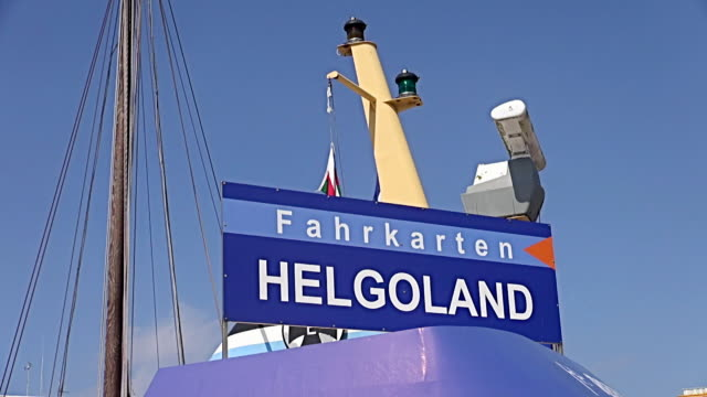 ms shot of ferry signboard helgoland, north sea, north frisia / busum, schleswig holstein, germany - helgoland stock videos & royalty-free footage