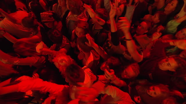 ms ha pov shot of festival crowd waving their hands in air with red and yellow lights / isle of wight, london, united kingdom - concert stock videos & royalty-free footage
