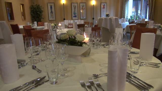 ms shot of festive decorated restaurant / trassem, rhineland-palatinate - messer stock-videos und b-roll-filmmaterial