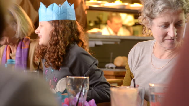 ms shot of festive lunch in pub, three generations of family, grandma and mum and two girls and two boys / london, england, united kingdom - multi generation family stock videos & royalty-free footage