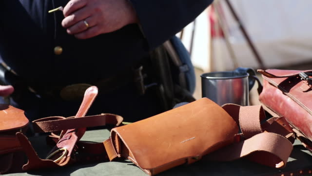 cu pan shot of few civil war reinactment props / santa fe, new mexico, united states - horse cart stock videos and b-roll footage