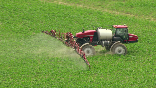 CU AERIAL TS ZO Shot of field sprayer spraying on fields in Tallahatchie County / Mississippi, United States