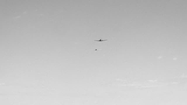WS LA Shot of fighter plane being shot down by another fighter plane. War