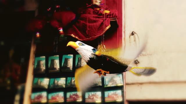 ms shot of figurine of eagle on souvenir shop at red fort / delhi, india - rappresentazione di animale video stock e b–roll