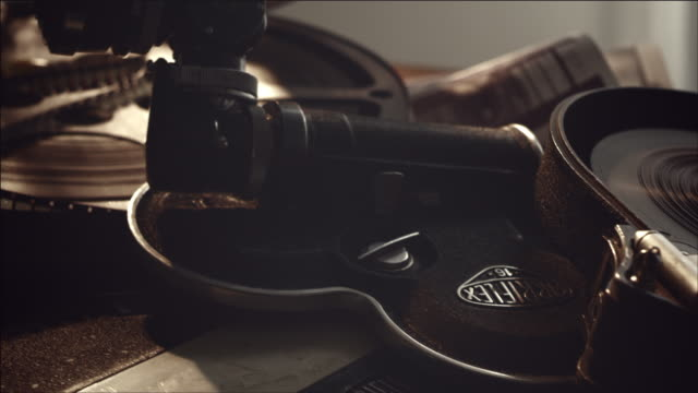 Shot of film camera and Film Canister,	Film Reel with turning Electric Fan