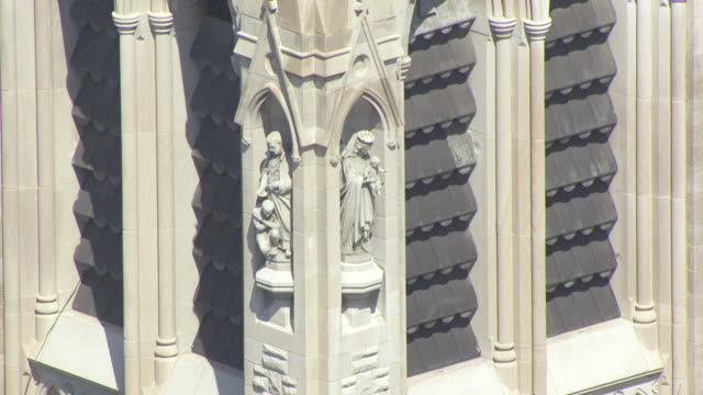 cu aerial ts zo shot of fine details of sculpture in bell tower of st francis xavier college church / st louis, missouri, united states - st. louis missouri stock videos & royalty-free footage