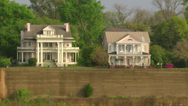 MS AERIAL Shot of fine homes and mansions with large retention wall and overlooking Mississippi River / Natchez, Mississippi, United States