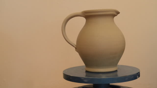 ms shot of finishing pitcher on potterwheel at pottery / landshut, bavaria, germany - pitcher jug stock videos & royalty-free footage