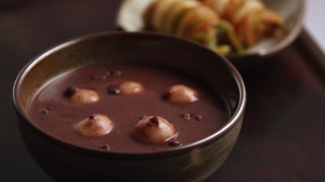 cu r/f shot of finishing red bean soup (rice-cake red-bean soup) / seoul, south korea - legume family stock videos and b-roll footage