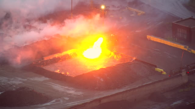 cu aerial ds ts zo shot of fire being poured at severstal steel plant / dearborn, michigan, united states - dearborn michigan stock videos and b-roll footage