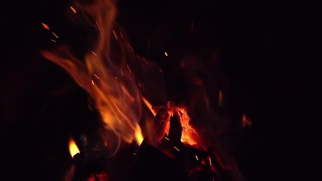 CU SLO MO Shot of Fire flames in campfire, campsite / Moremi Reserve, Africa, Botswana