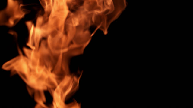 slo mo shot of fire flames on black background - flaming torch stock videos & royalty-free footage