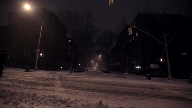 MS Shot of Fire truck driving by, snow covering street at night / Manhattan, New York, United States