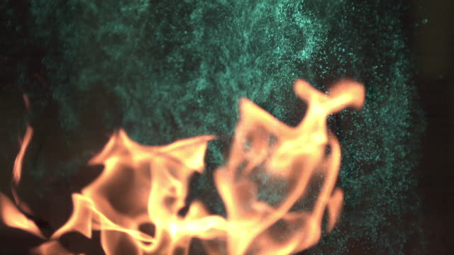 shot of fire with fire extinguisher mist - fire extinguisher stock videos & royalty-free footage