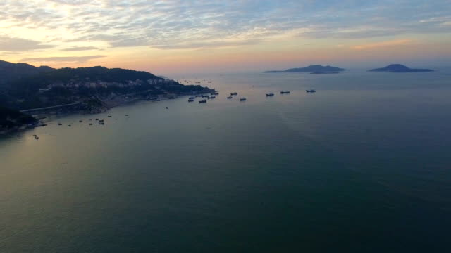 AERIAL shot of fishing boat in sea and island at sunrise/Fujian,Chin