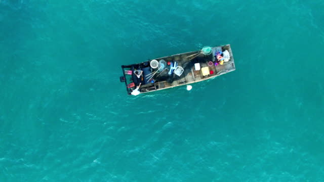 ws aerial shot of fishing boat in sea at sunset/fujian,china - fischerboot stock-videos und b-roll-filmmaterial