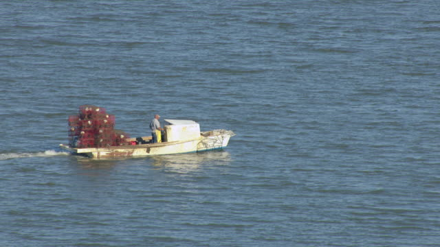 stockvideo's en b-roll-footage met ms aerial ts shot of fishing boat moving in water / alabama, united states - gulf coast states