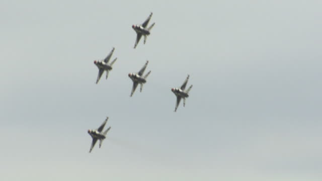 MS TS Shot of five F16 Thunderbird jets flying in formation during air show at Andrews Air Force Base / Prince George's County, Maryland, United States