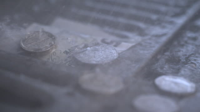 cu slo mo shot of five pound note and some coins being washed down a drain - british pound sterling note stock videos & royalty-free footage