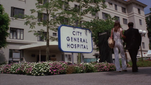 ms shot of five story city general hospital - entrance sign stock videos & royalty-free footage