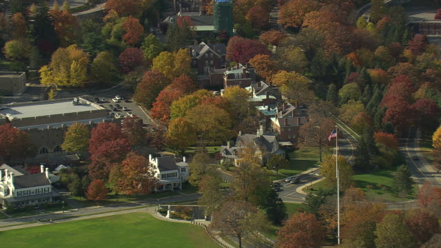 WS AERIAL ZI ZO PAN Shot of flag blowing in wind at West Point Military Academy / New York, United States