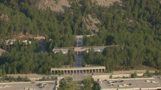 CU AERIAL TS ZO Shot of flag lined entrance to Memorial Complex at Mount Rushmore and pull out to memorial / South Dakota, United States