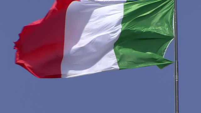 CU Shot of Flag of Italy flying in wind / Turin, Piedmont, Italy
