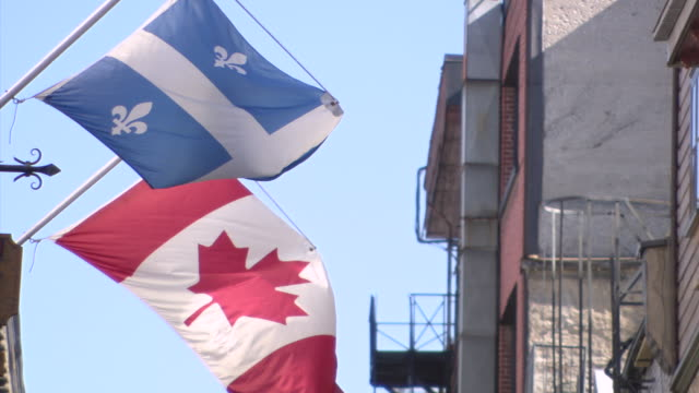cu shot of flag waving in wind / quebec, canada - quebec flag stock videos & royalty-free footage