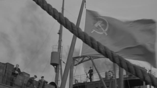 ms pan shot of flag with men against rail on russian ship - former ussr flag stock videos & royalty-free footage