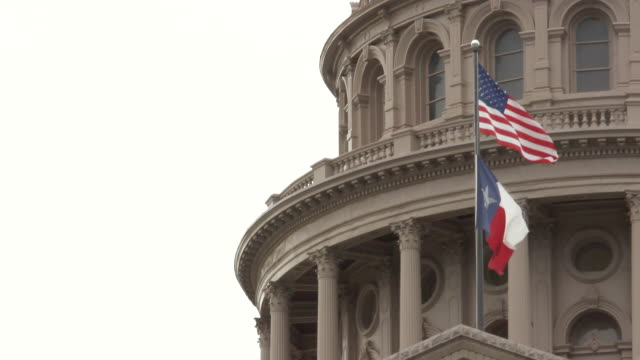 ms shot of flags waving in front of capital building / austin, texas, united states - texas state capitol building stock videos & royalty-free footage