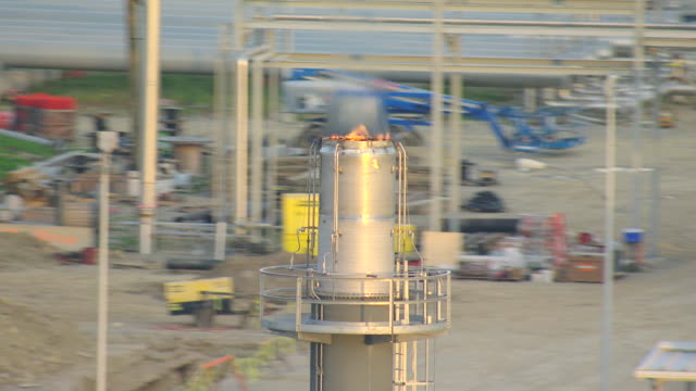 CU AERIAL DS Shot of flame at top of large pipe at Houston Plant gas mining at Marcellus Shale Formation / Pennsylvania, United States