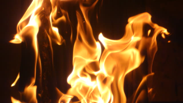 ecu slo mo shot of flames in an industrial oven - flamme stock-videos und b-roll-filmmaterial