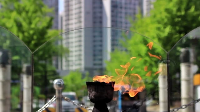 ms t/l shot of flaming torch of olympic park in seoul / seoul, south korea - olympic torch stock videos & royalty-free footage