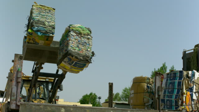 ms slo mo shot of flatbed truck with recycle card board blocks dropping from front loader truck / elgouna, red sea, egypt - red sea stock videos & royalty-free footage