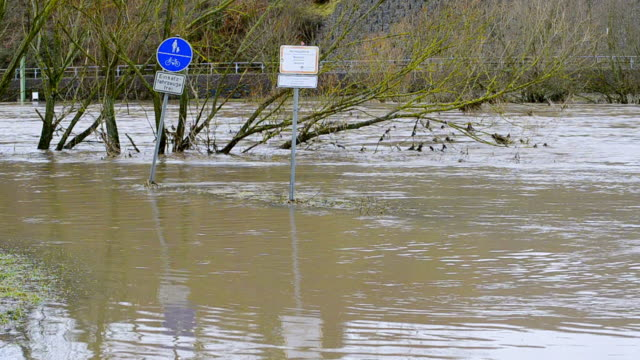 ws shot of flood waters of brook/ schoden, rhineland palatinate, germany - überschwemmung stock-videos und b-roll-filmmaterial