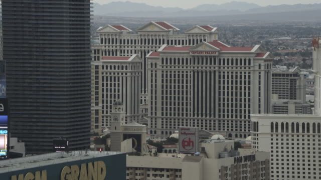 MS AERIAL TU Shot of Fly over MGM Grand to Ceasars Palace / Las Vegas, Nevada, United States