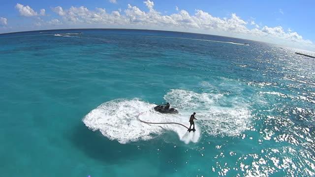 vídeos y material grabado en eventos de stock de ms aerial ts shot of flyboarding in playa del carmen beach / playa delcarmen, united states - playa del carmen