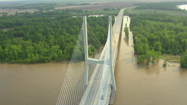 MS AERIAL Shot of flyover new US 82 Greenville Bridge with large steel beams in Washington County / Mississippi, United States