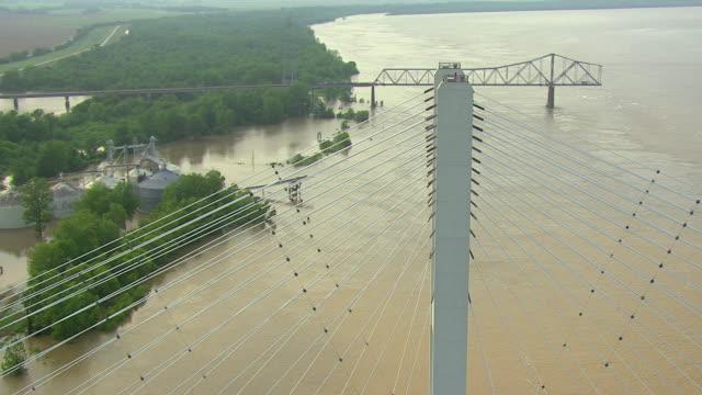 MS AERIAL TD Shot of flyover steel beams of US 82 Greenville Bridge over Mississippi River with old bridge / Mississippi, United States