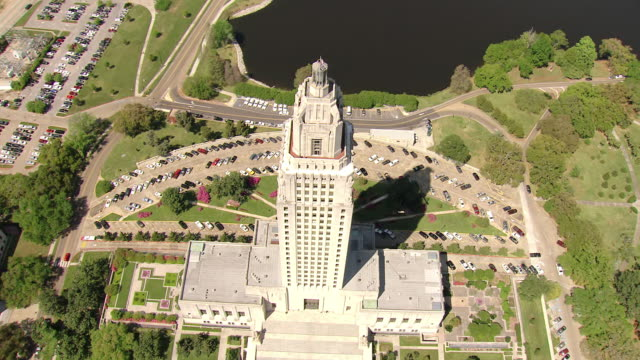 ms aerial shot of flyover top of louisiana state capitol building / baton rouge, louisiana, united states - baton rouge stock-videos und b-roll-filmmaterial