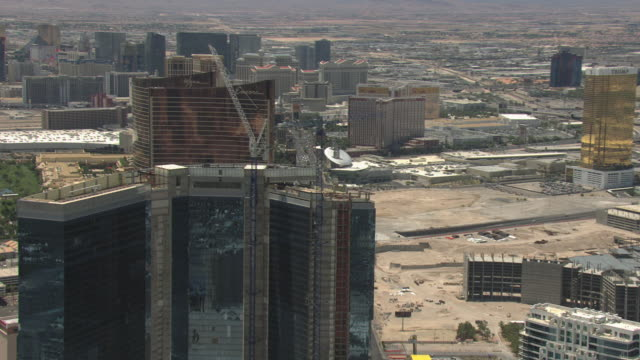 ms aerial shot of fontainebleau hotel and casino building under construction / las vegas, nevada, united states - las vegas stock videos & royalty-free footage
