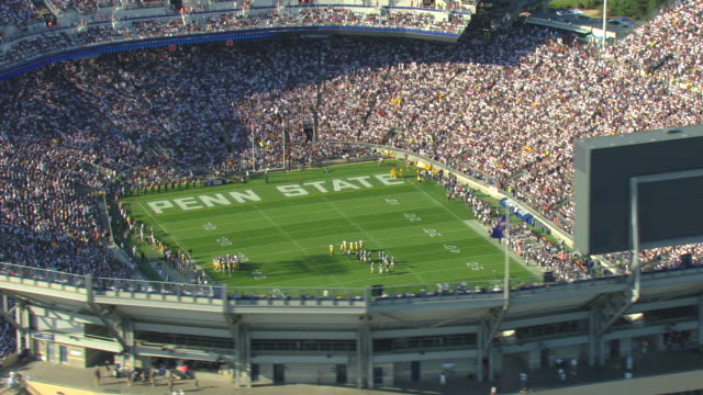 ms aerial shot of football game at beaver stadium at pennsylvania state university with fans in seats / university park, pennsylvania, united states - football player stock videos & royalty-free footage