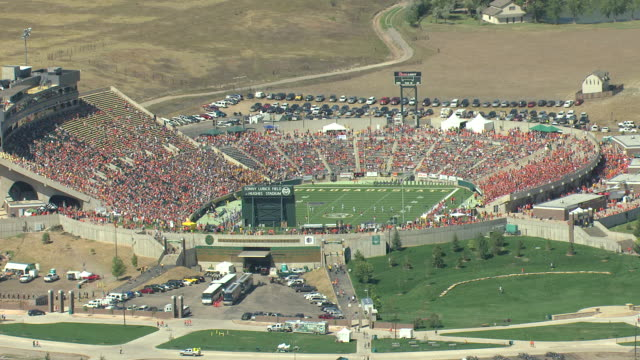 WS DS ZI AERIAL Shot of football players on field and spectators in seats in colorado state university football stadium / Fort Collins, Colorado, United States