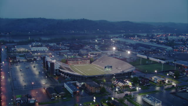aerial pov zi  shot of football stadium / unspecified - conditions stock videos and b-roll footage
