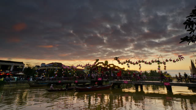 WS T/L Shot of footbridge over thu bon river at sunset / Hoi An, Quang Nam, Vietnam