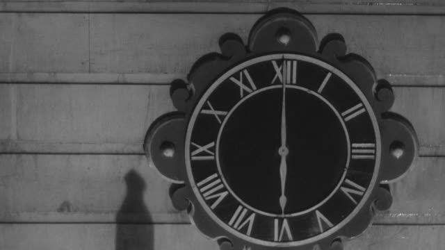 cu shot of footsteps of soldiers to clock on church exterior - the march of time stock videos & royalty-free footage
