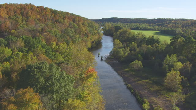 MS AERIAL TU Shot of forest and river en route northwest of Saco in south Madison County / Missouri, United States